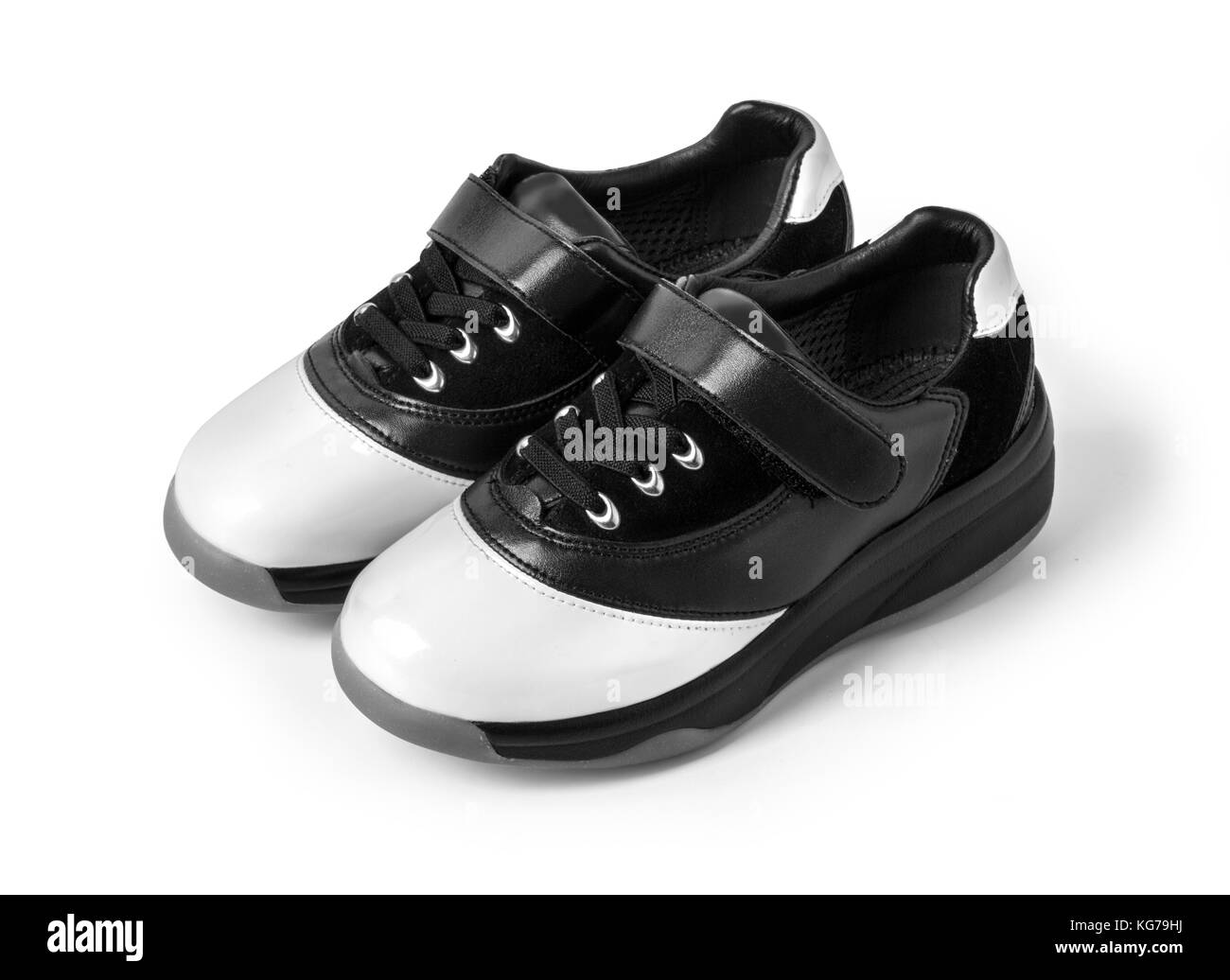 Two-tone black and white  leather  shoes on white with clipping path - Stock Image