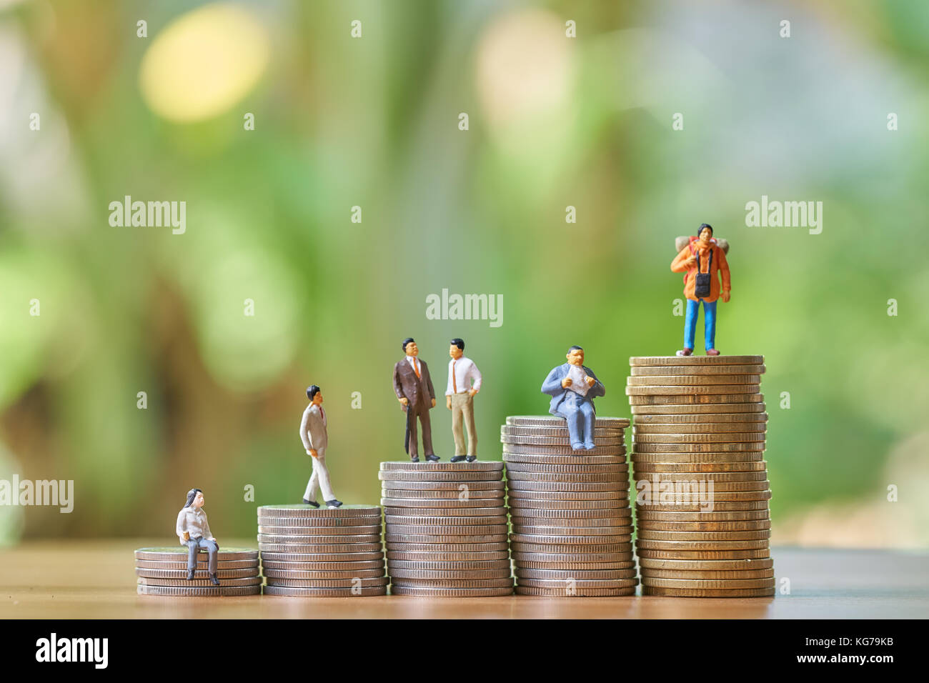 Money, Financial, Business Growth concept, Group of businessman miniature figures standing to top of stack of coins - Stock Image