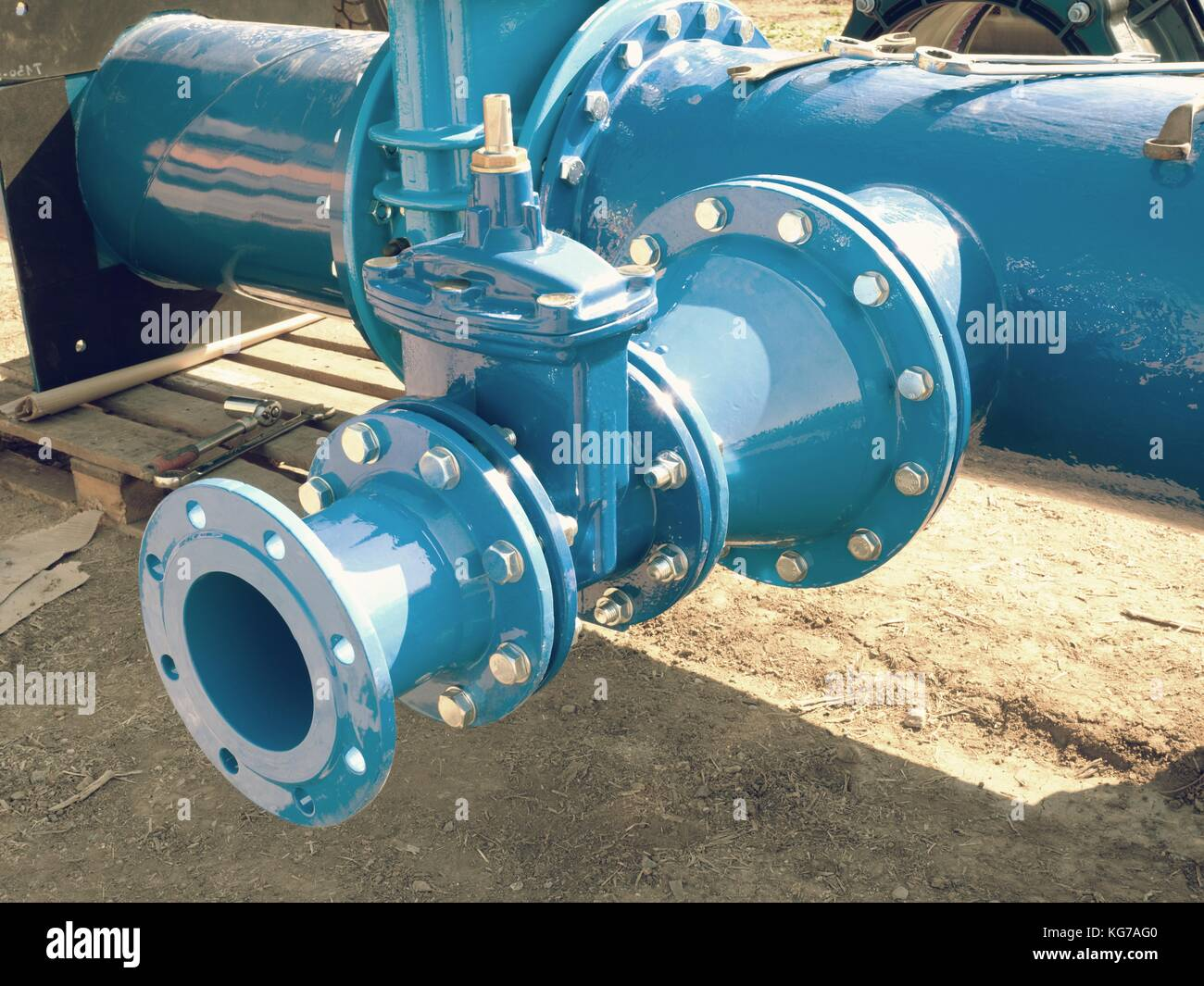 Dring water piping , Gate valves and reduction member. Pipe fittings joint with new screws and nuts. Repairing process - Stock Image