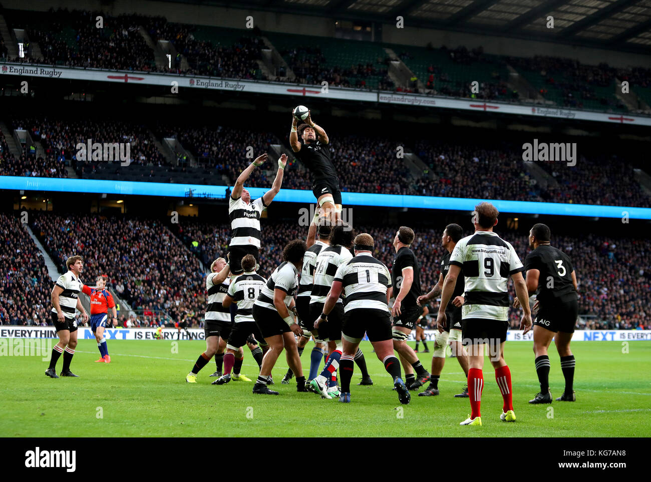 New Zealand's Ardie Savea (top) wins a lineout during the Autumn International match at Twickenham, London. - Stock Image