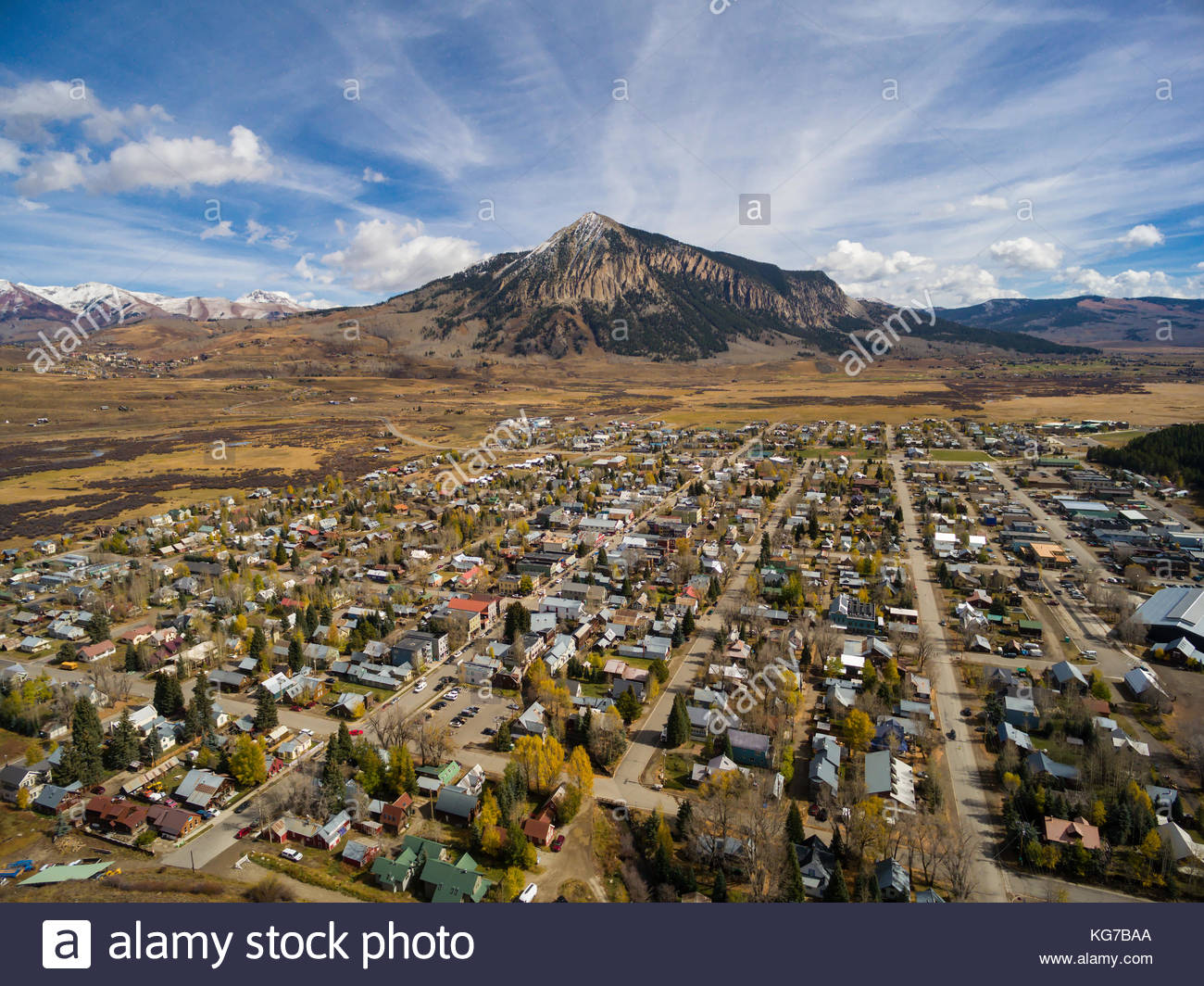 Aerial view of the town of Crested Butte, Colorado and Crested Butte Mountain on a beautiful fall day. - Stock Image