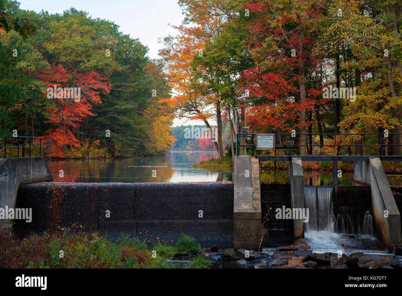 Trickling Falls Dam and Powwow Pond in autumn with bright fall foliage, East Kingston, New Hampshire, USA - Stock Image