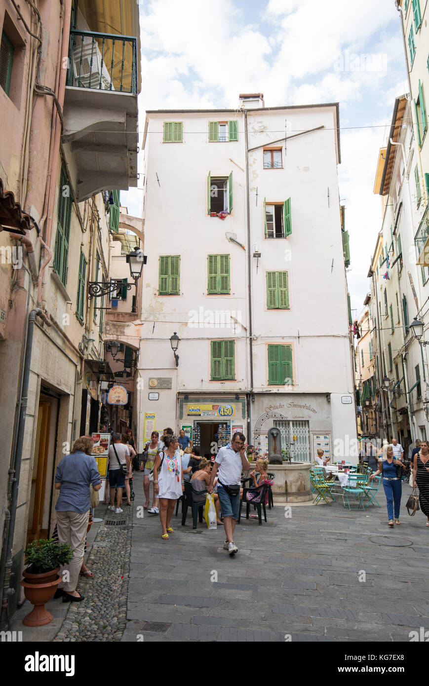 People enjoying food at pavement cafe, San Remo, Italy. Stock Photo