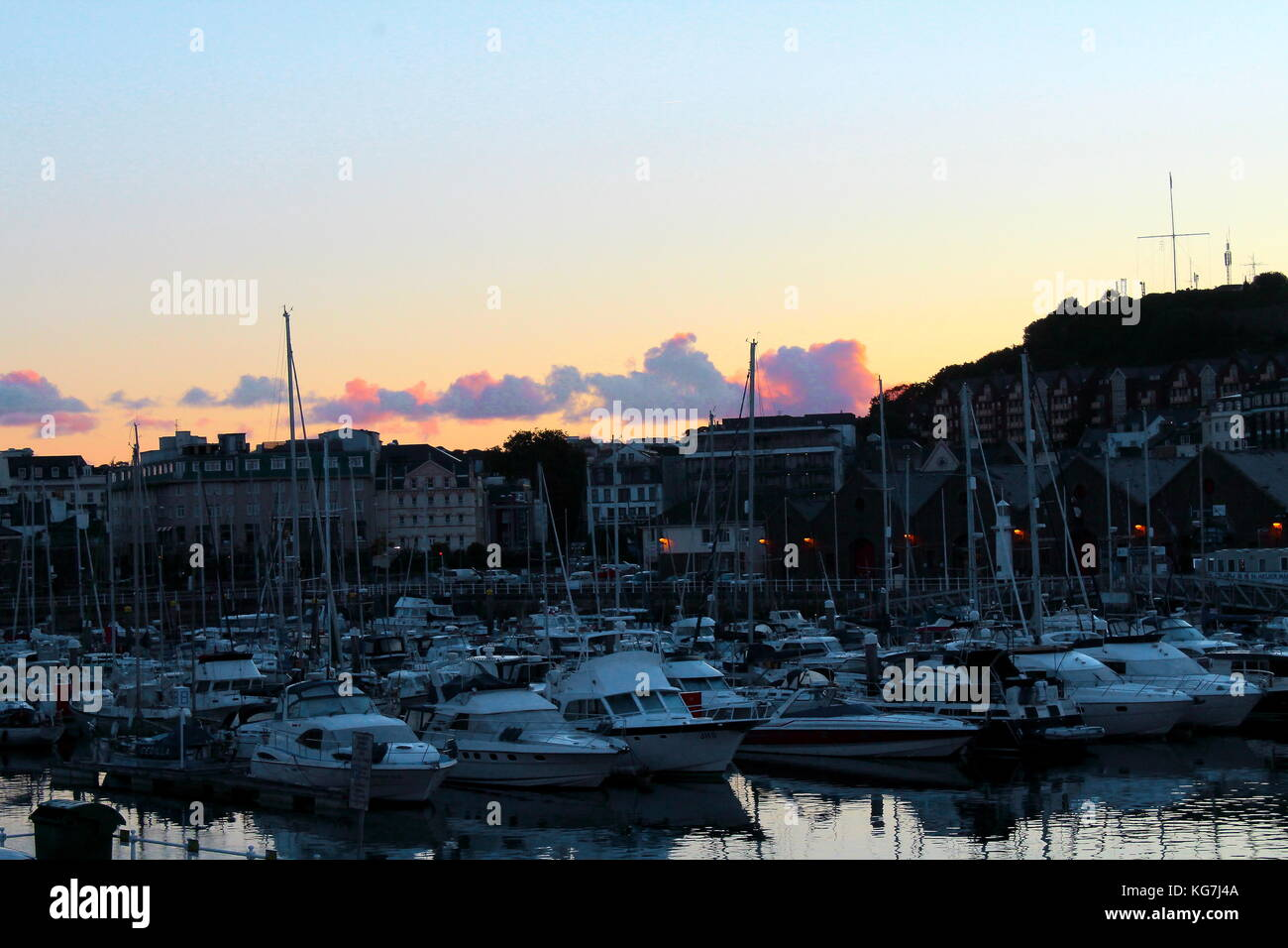 St Helier Harbour at Sunrise - Stock Image