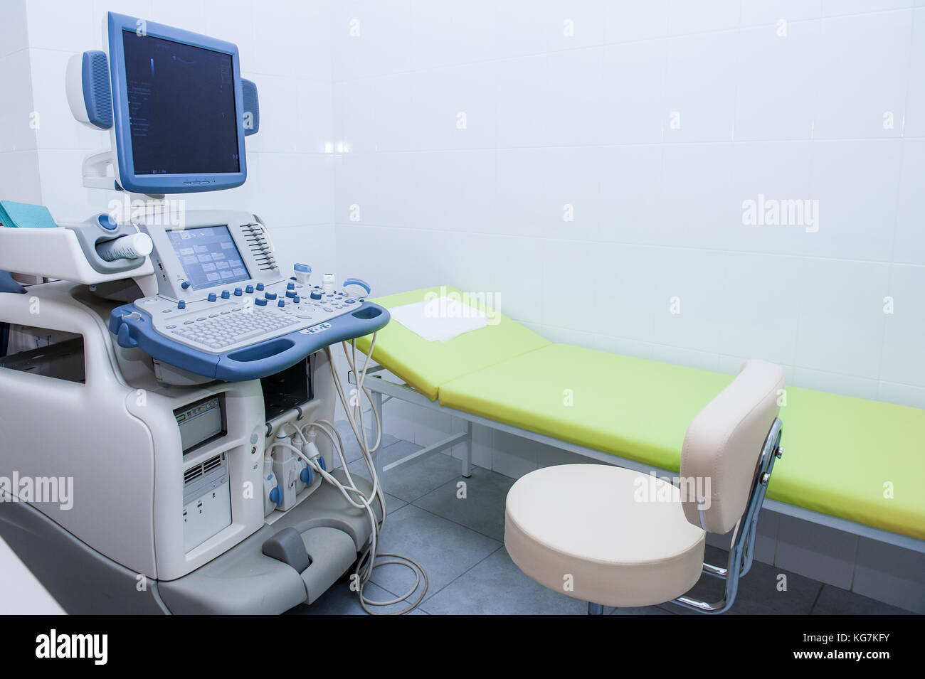 Interior of examination room with ultrasonography machine in hospital. Selective focus. - Stock Image