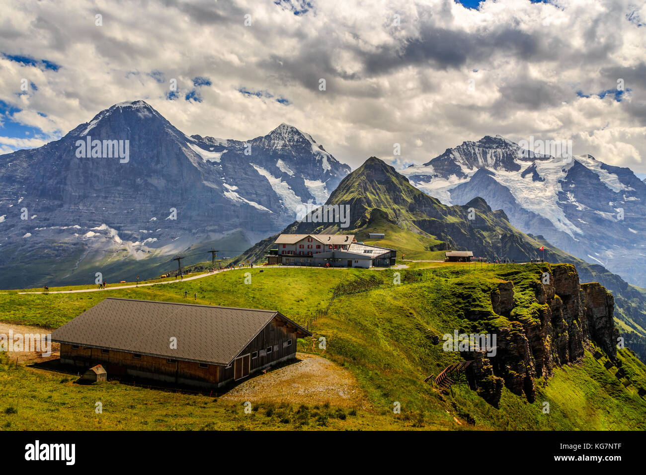Stunning view on worldfamous mountain trio Eiger, Monch and Jungfrau with Tschuggen in the foreground. Seen from - Stock Image