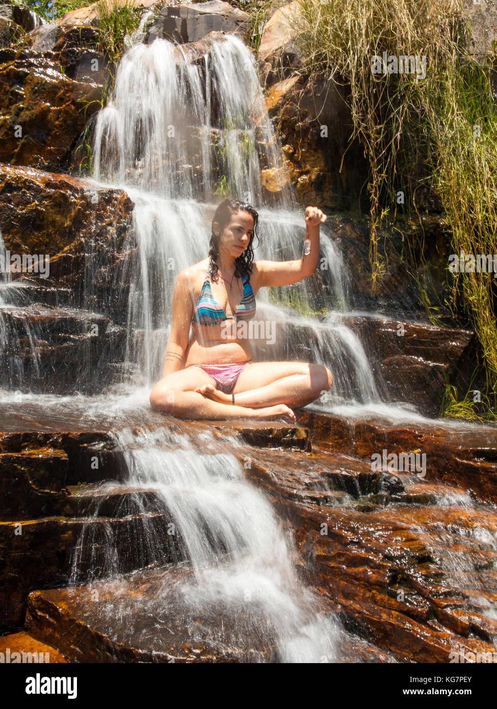 Tourist bathing at Almecegas II Waterfall, Chapada dos Veadeiros, Goias, Brazil - Stock Image