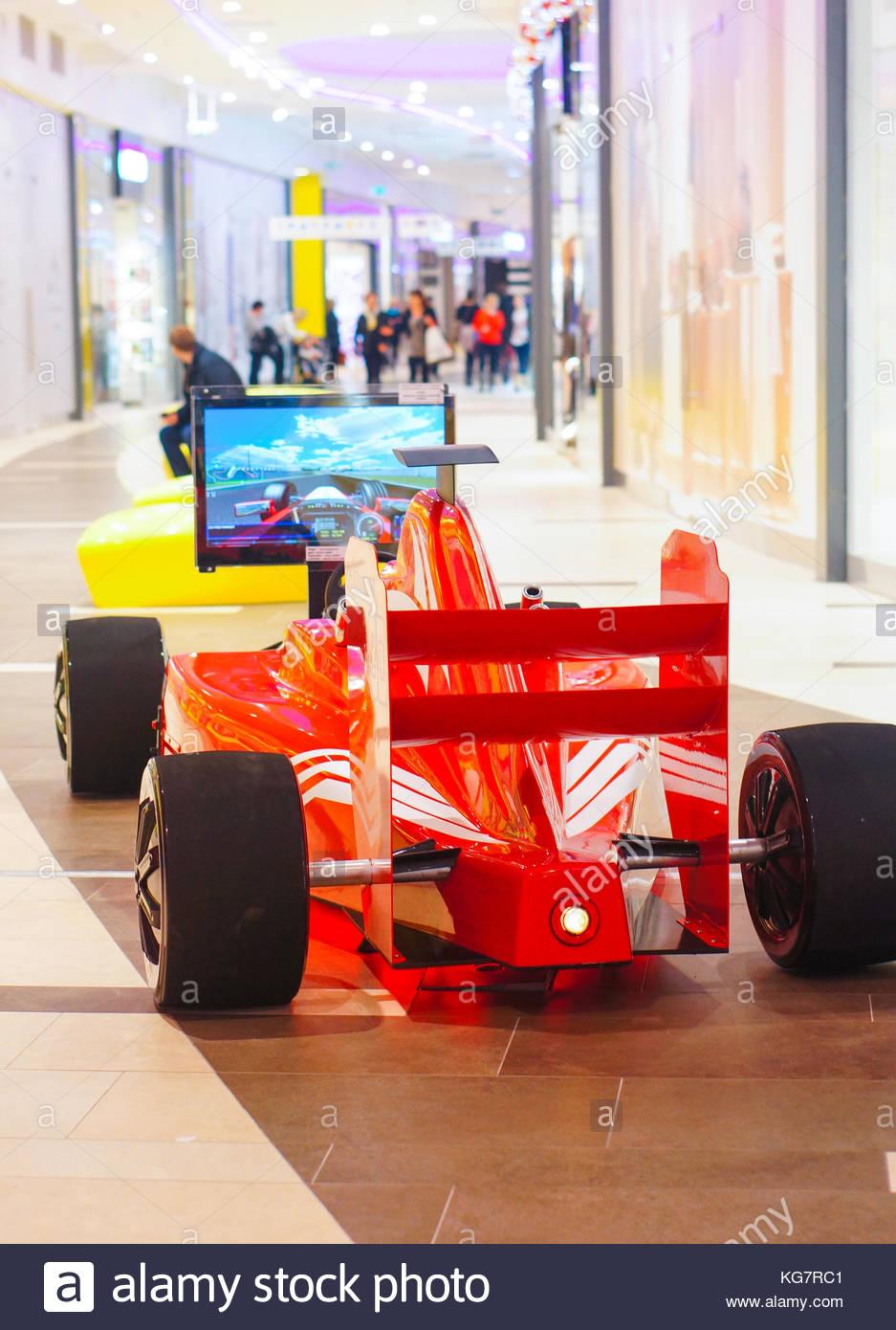 POZNAN, POLAND - JANUARY 19, 2014: Formula 1 race simulator in the Poznan City Center shopping mall - Stock Image