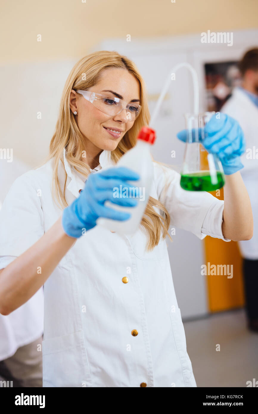 Attractive student of chemistry working in laboratory - Stock Image