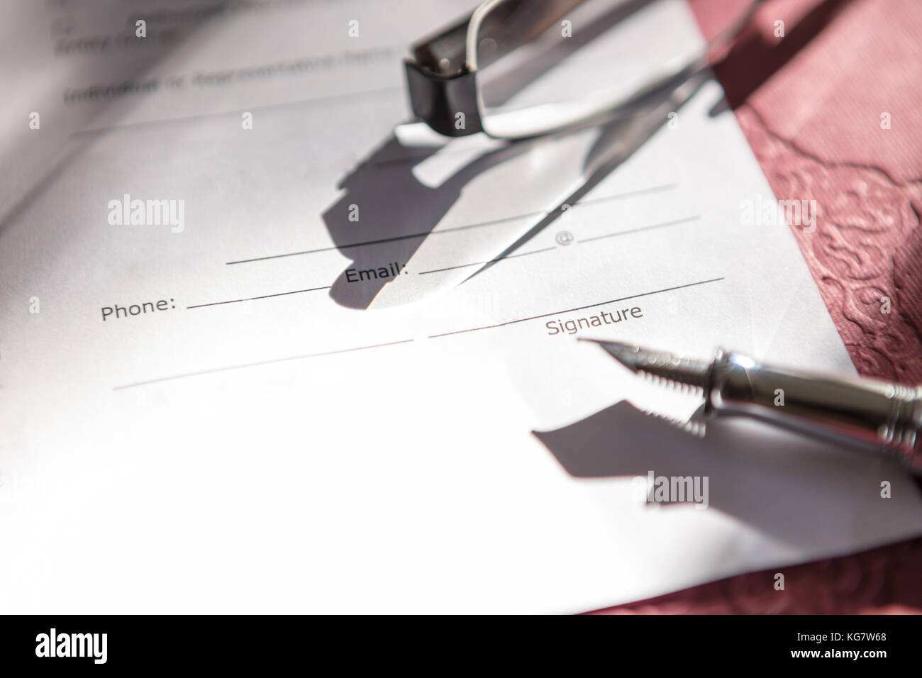 Close-up of Contract form with fountain pen and glasses Stock Photo