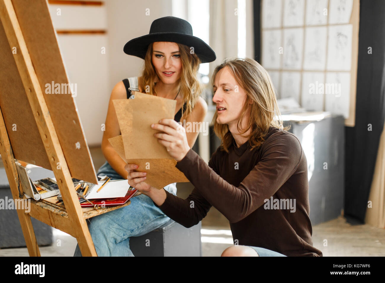 Artist Consult his Colleague while Drawing - Stock Image