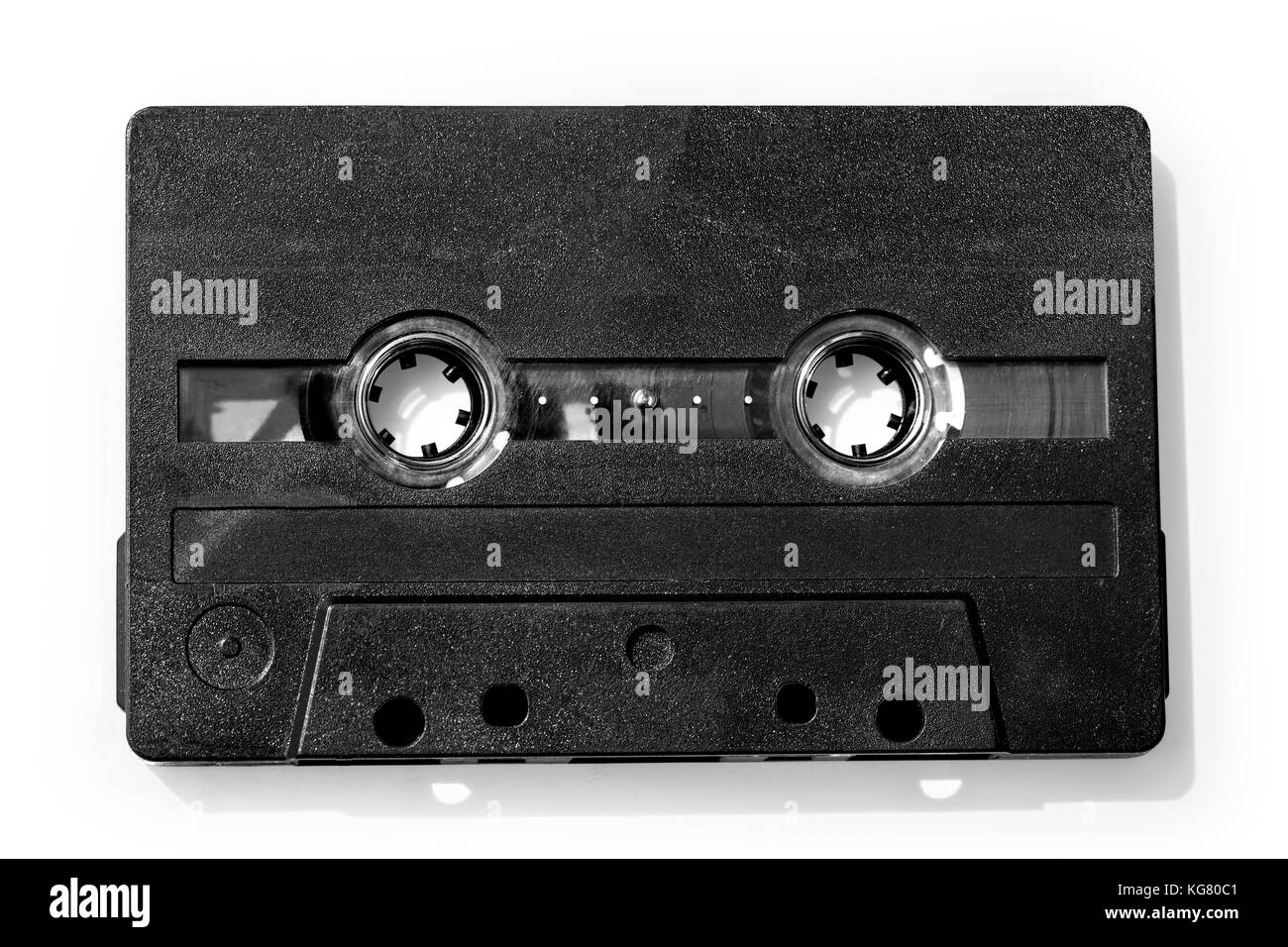 Old compact audio cassette (tape), macro shot on white background,with clipping path - Stock Image