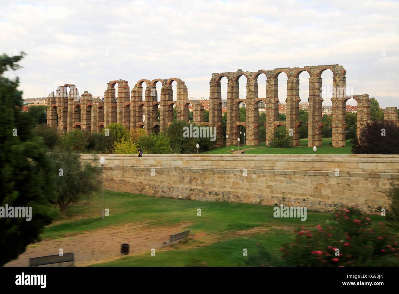 Blurred motion shot from speeding train of Roman aqueduct, Acueducto de Los Milagros, Merida, Extremadura, Spain - Stock Image