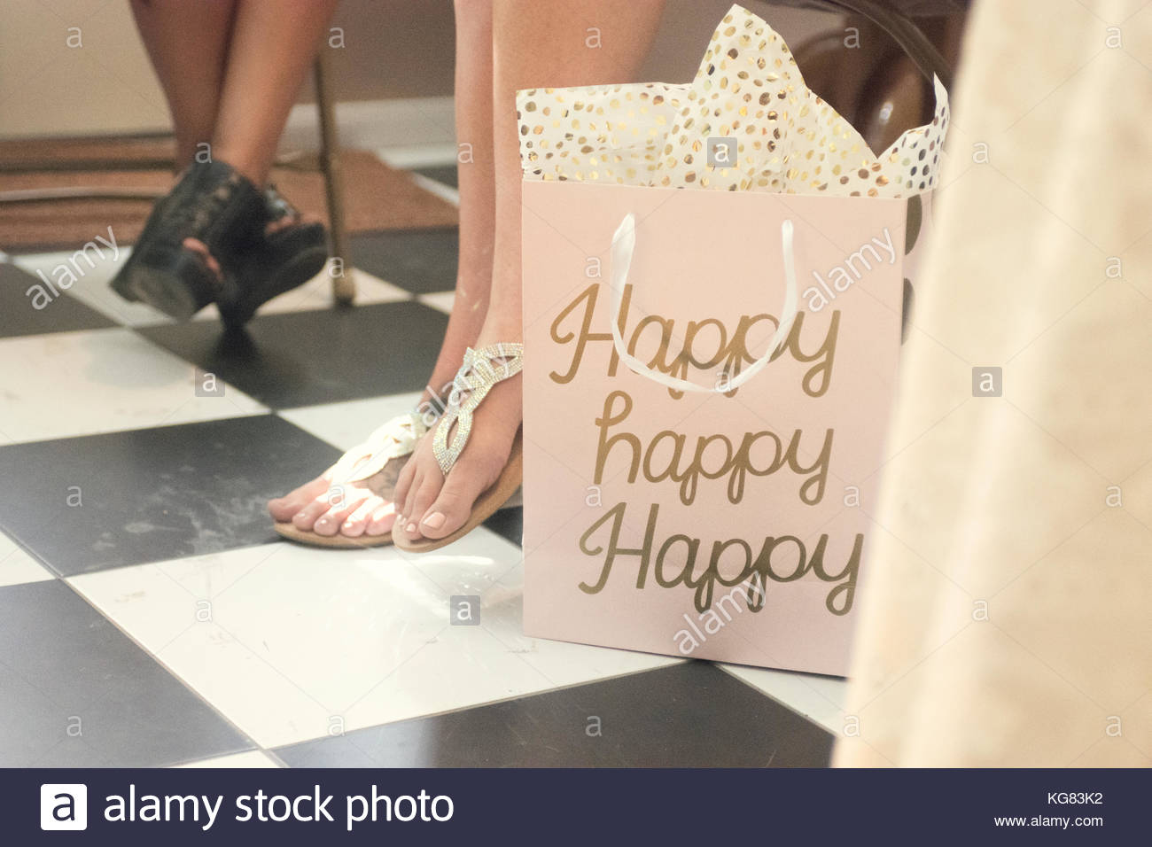 gift bag with happy written on it next to feet at bridal shower in los angeles california
