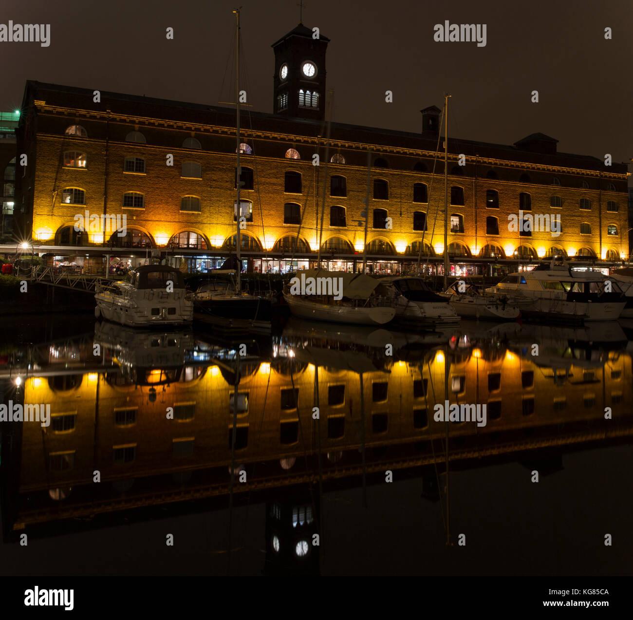 St. Katharine's Dock at night. - Stock Image