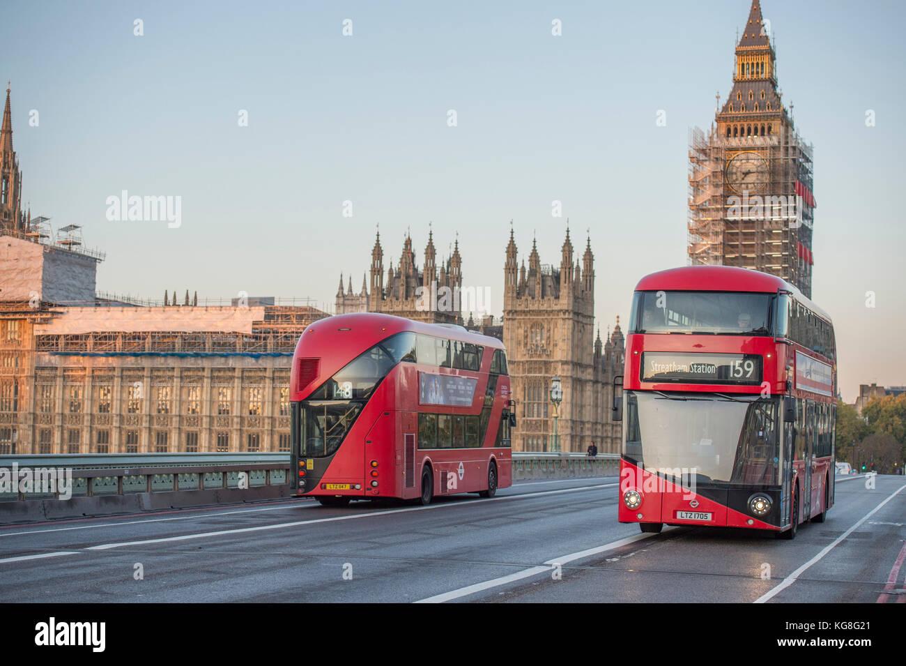 Westminster Bridge, London, UK. 5 November, 2017. Two New Routemaster buses  cross Westminster Bridge in opposite Stock Photo