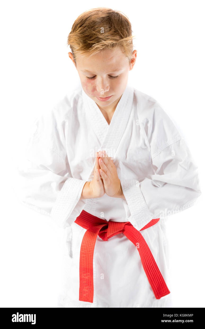 Pre-teen boy in martial arts uniform doing martial arts - Stock Image