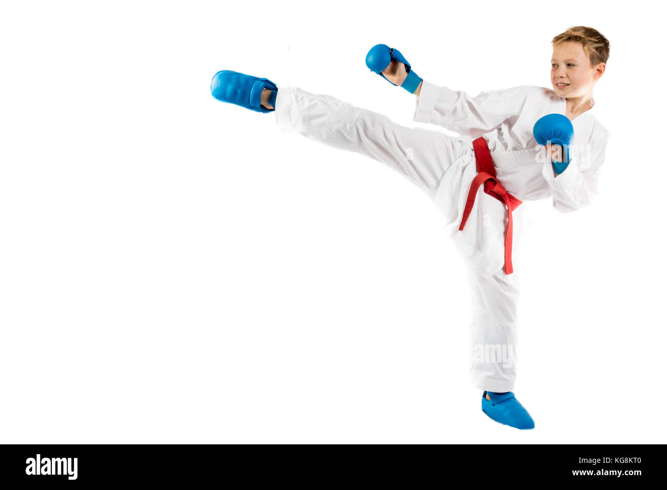Pre-teen boy doing karate on a white background - Stock Image