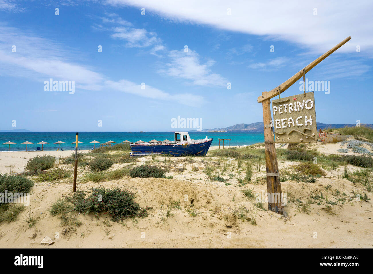 Old fishing boat at the dunes of Petrivo beach, west side of Naxos, Cyclades, Aegean, Greece - Stock Image