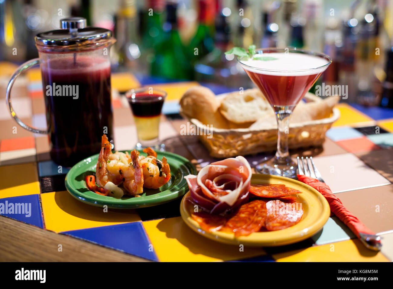 Booze party tapas bar still life scene. Beautiful cocktails, shot and long drinks, cold starters marinated shrimp - Stock Image