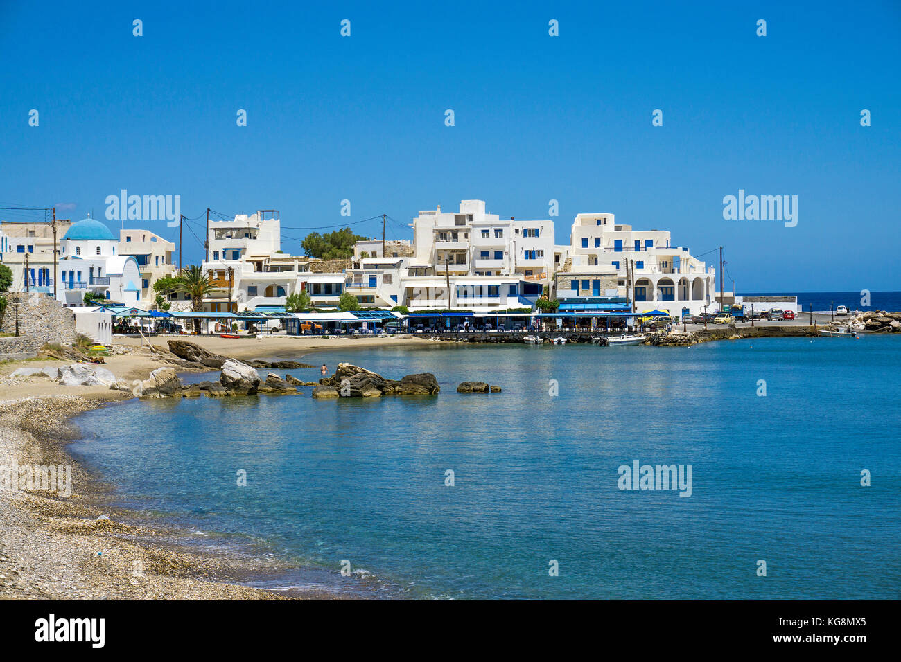 Beach and harbour of the small fishing village Apollonas, North side of Naxos island, Cyclades, Aegean, Greece - Stock Image