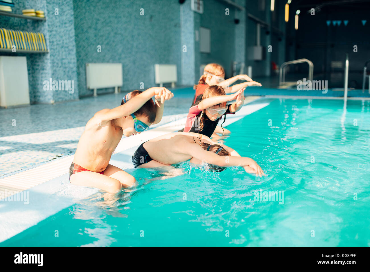 Children jumping into sport swimming pool. Sporty kids. Boys ...