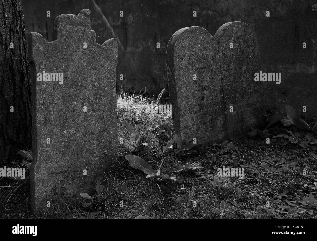 Old, worn and weathered tombstones in the corner of the cemetery. General Protestant Cemetery, St. John's, Newfoundland - Stock Image