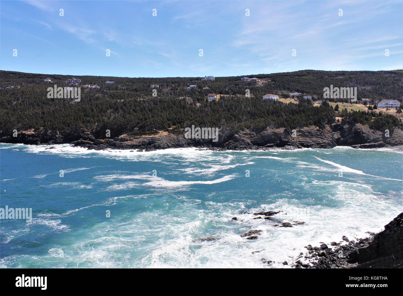 Waves breaking against the rocky cliffs and rugged coastline, Logy Bay-Middle Cove-Outer Cove, Newfoundland Labrador - Stock Image