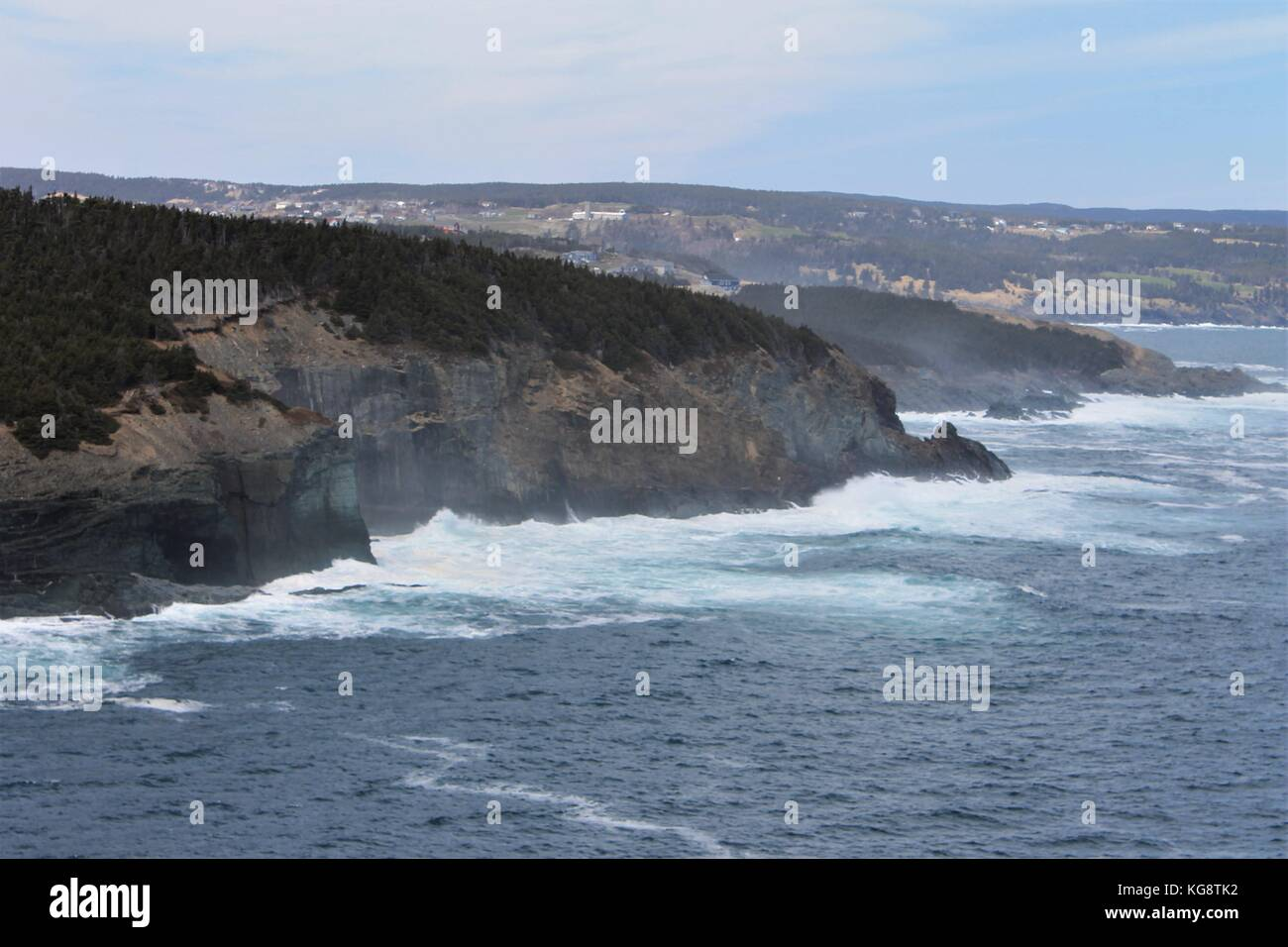 Waves breaking against the cliffs, Logy Bay-Middle Cove-Outer Cove, Newfoundland and Labrador, Canada. Light fog, Stock Photo