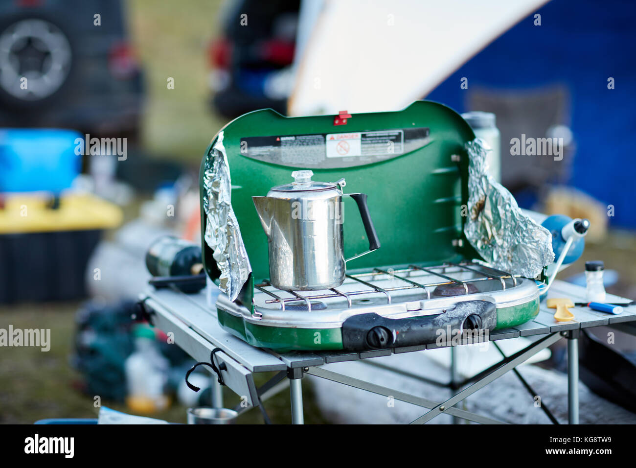 Stainless Steel Coffee Pot Heating On A Small Portable Camping Gas