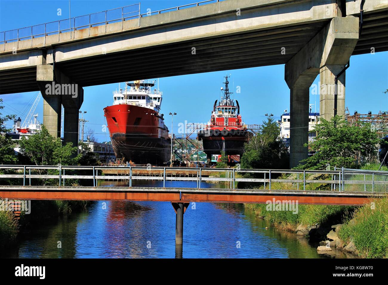 Looking down the Waterford River toward St. John's Harbour where two ships are in dry dock, St. John's, - Stock Image