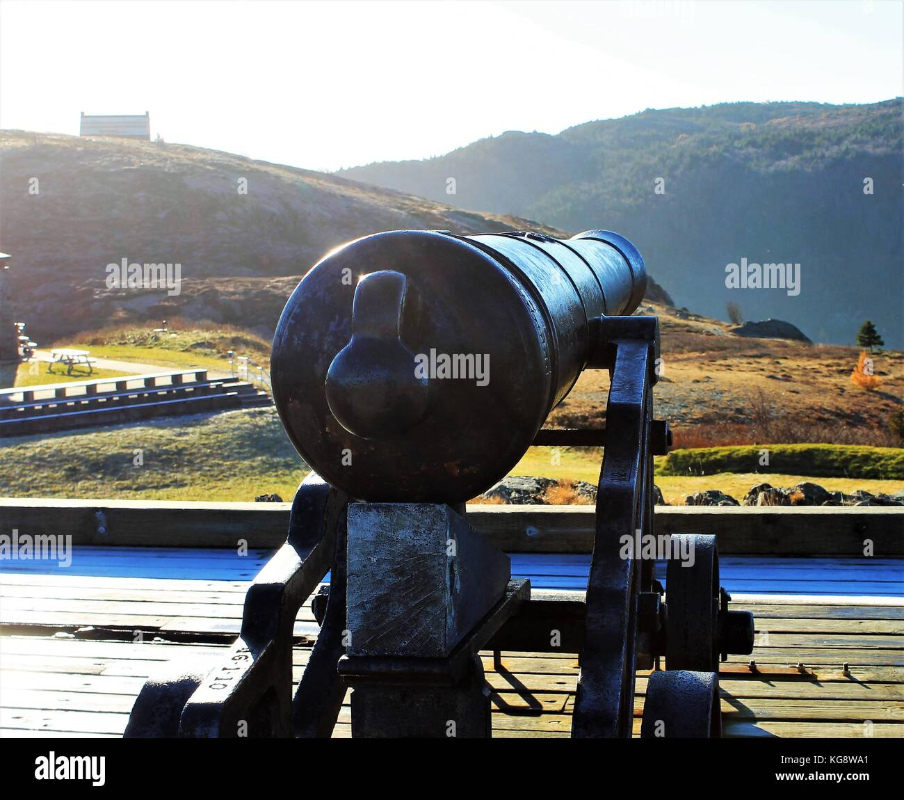 Cannon on Signal Hill, St. John's, Newfoundland and Labrador, Canada. Sun reflecting of the barrel, frost on - Stock Image
