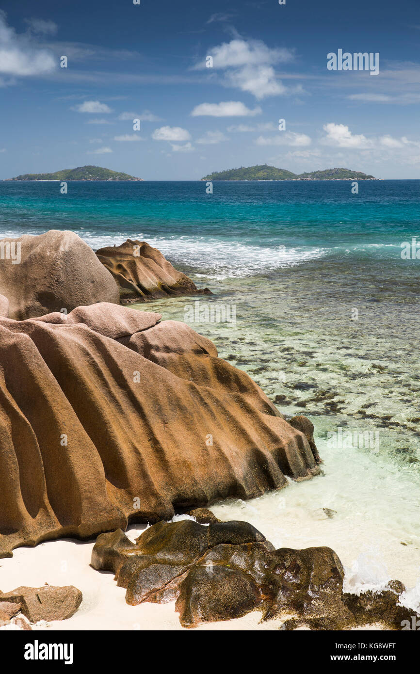 The Seychelles, La Digue, Anse Formis, east coast, rocky shore, beach and shallow lagoon opposite Felicite island Stock Photo