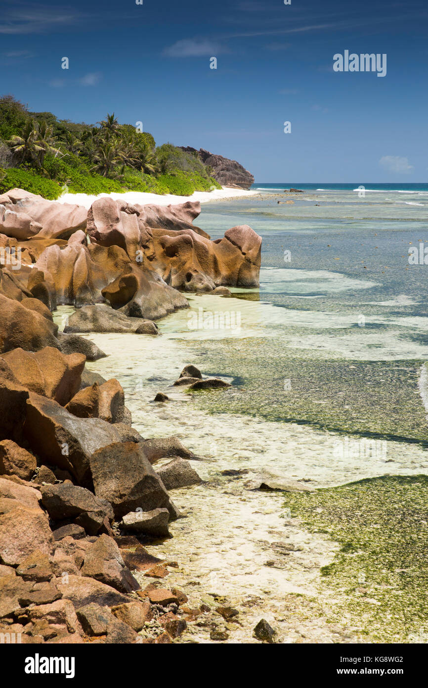 The Seychelles, La Digue, Anse Formis, east coast, rocky shore, beach and shallow lagoon Stock Photo
