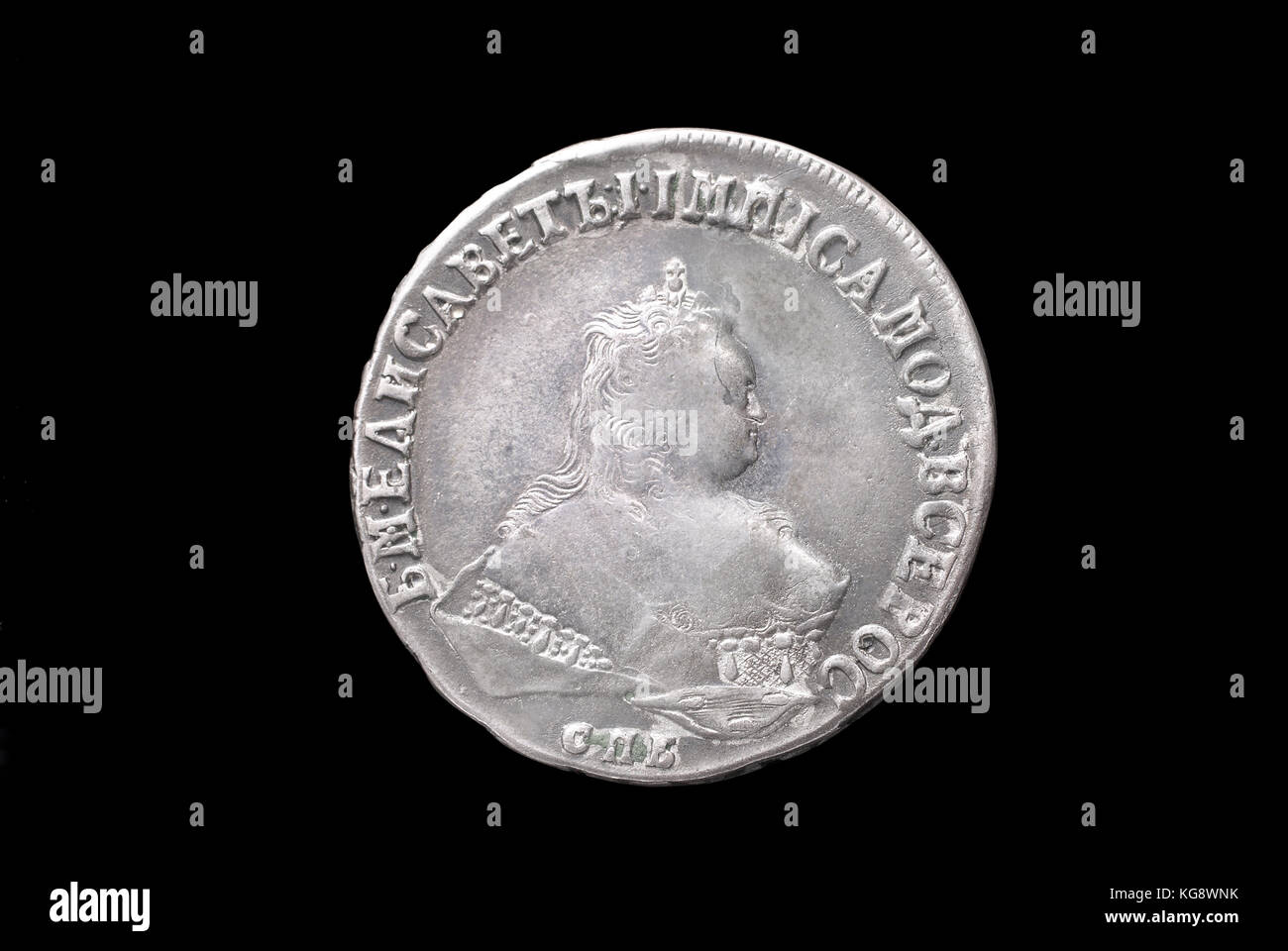 Russian ancient silver coin (empress Elizabeth II, 1 rouble, 1751). Obverse (of coin). - Stock Image