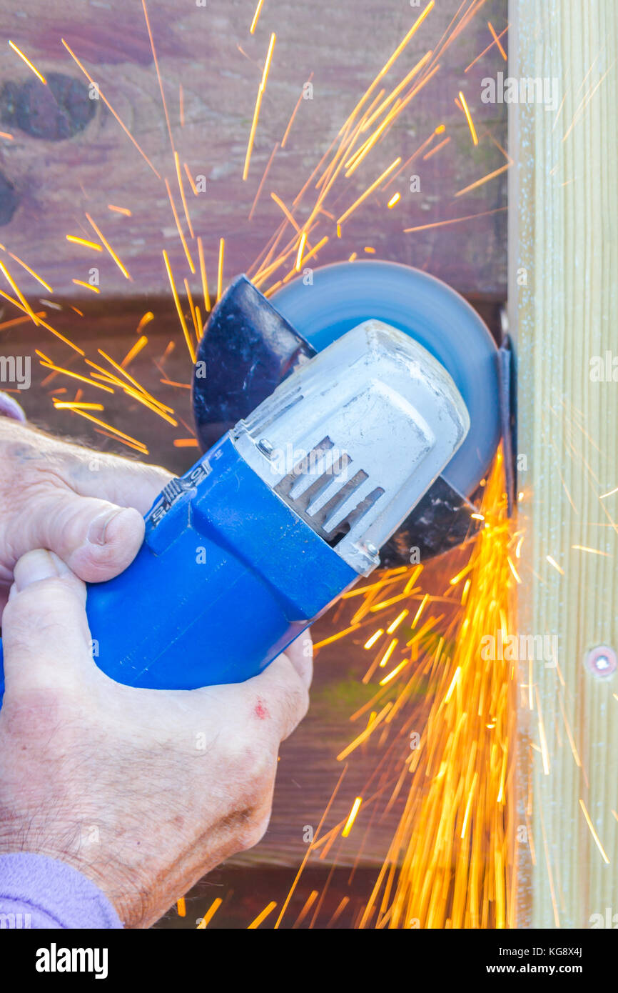 angle grinder cutting metal and making sparks - Stock Image