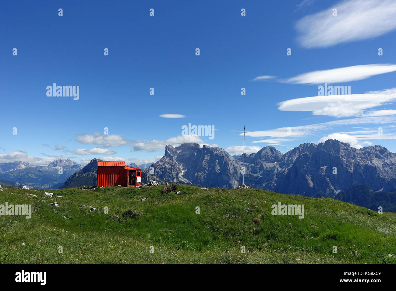 Beautiful mountain scenery in between the Dolomites area. In some minutes a helicopter will land and BASE jumper - Stock Image