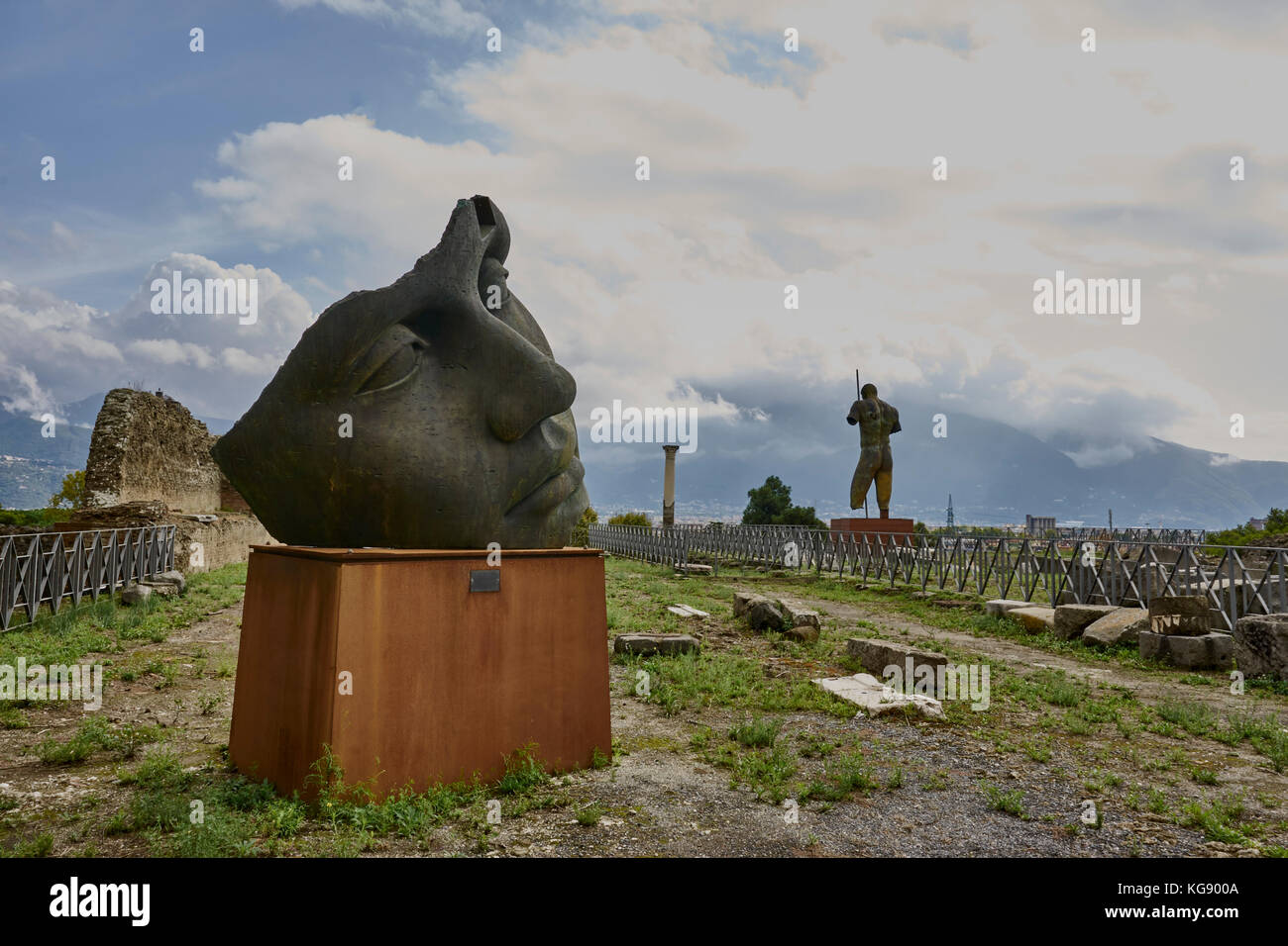 "Pompeii ruins exhibited after archaeological excavations. Modern sculptures by Igor Mitoraj. Bronze head ""Luci di Stock Photo"