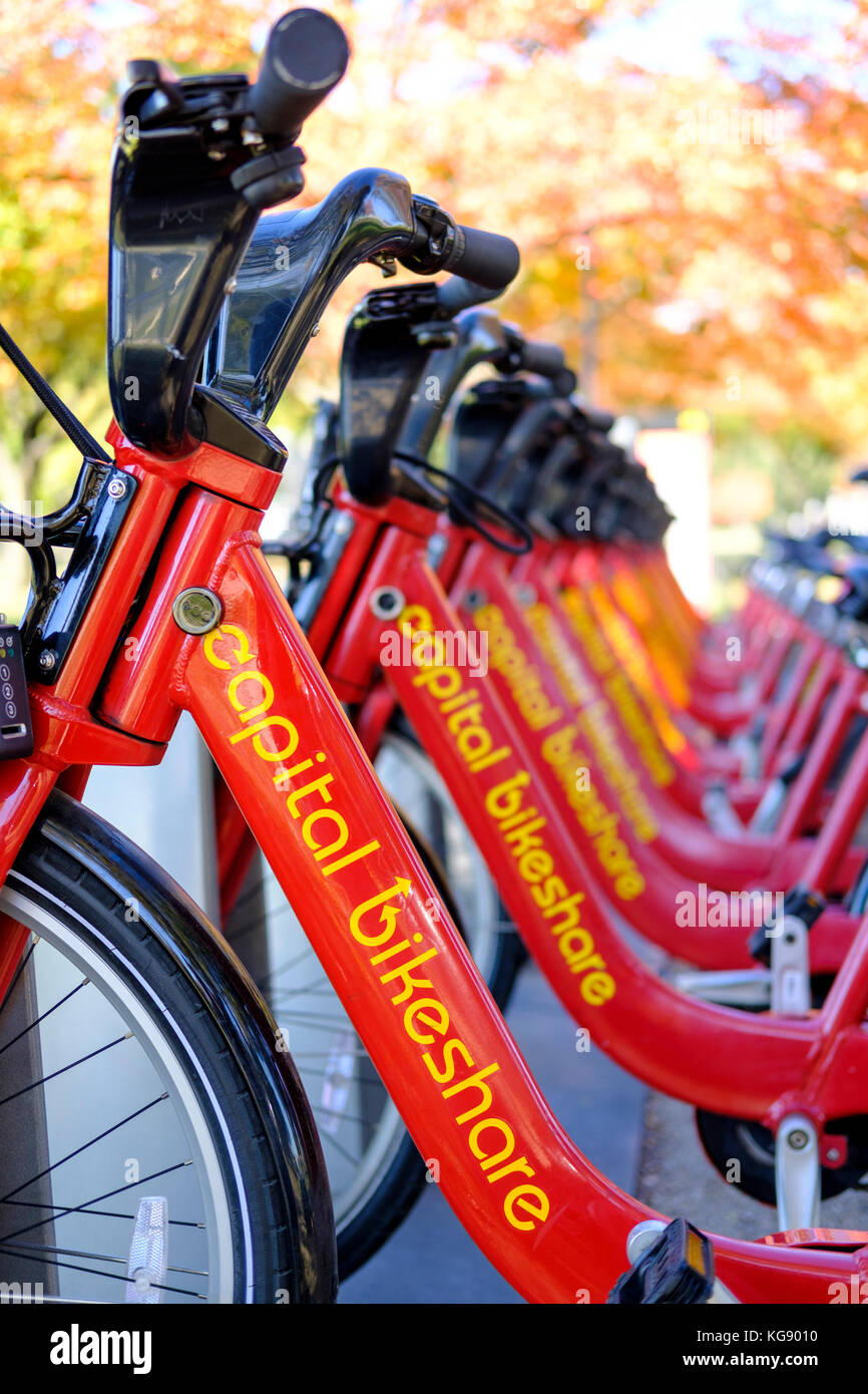 Capital Bikeshare bicycle rack with a row of red rental bikes in Washington, DC, United States of America, USA. - Stock Image