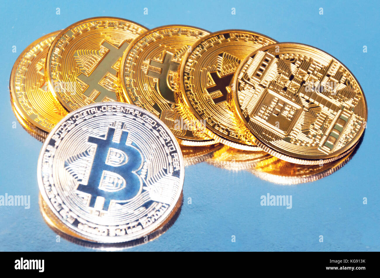 Several coins of bitcoins. Bright glow, toning and blurring. The concept of crypto currency - Stock Image