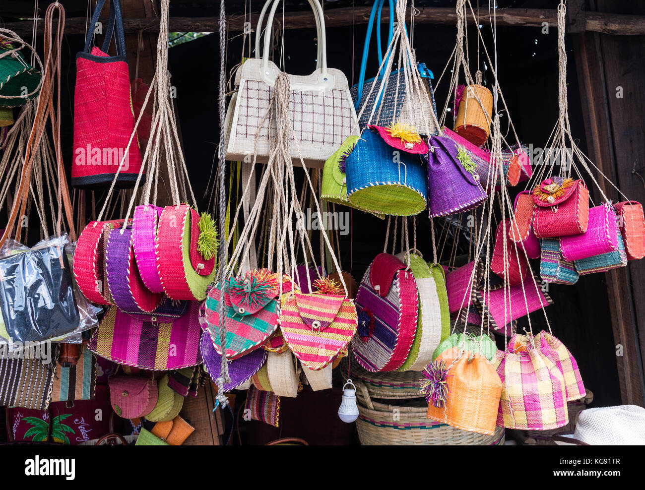Colorful hand-made purses and handbags for sale at a local market. Madagascar, Africa. - Stock Image