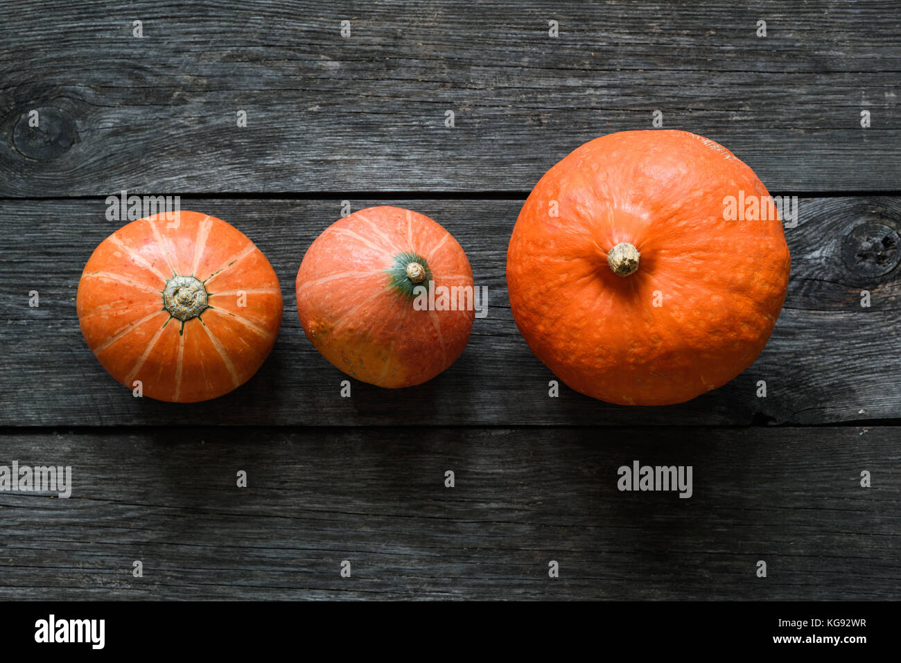 Autumn pumpkins harvest or Thanksgiving pumpkins on wooden table background. Top view - Stock Image