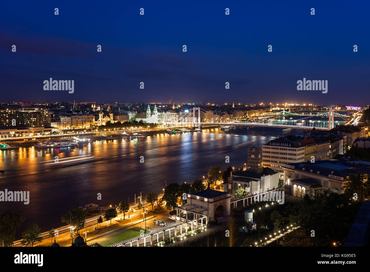 Budapest city skyline by night in Hungary, urban nightscape along Danube River - Stock Image