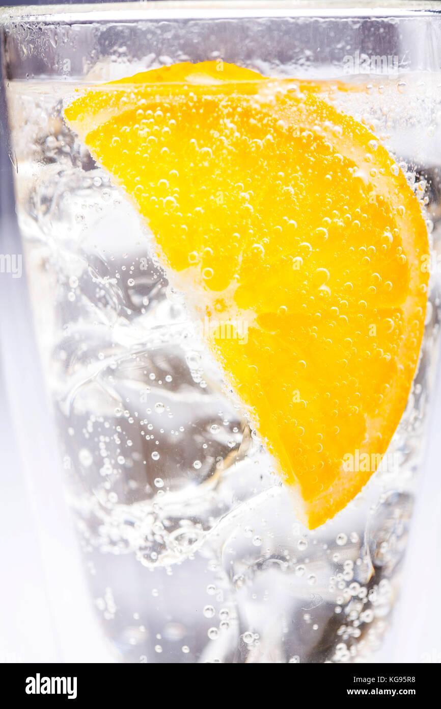 lemon slice in soda water and ice - Stock Image