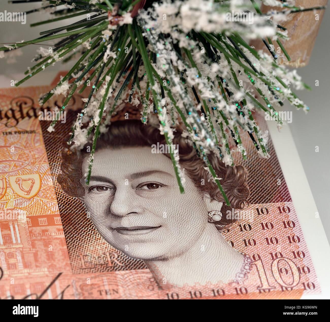 Christmas spending money queens head - Stock Image