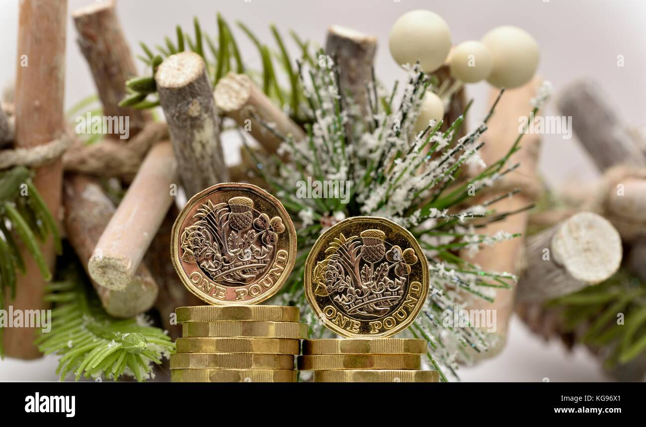 Christmas spending money one pound coins - Stock Image