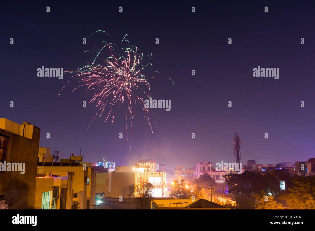 Beautiful fireworks over the suburb homes in jaipur city. This is a common sight on diwali, makar sankranti and - Stock Image