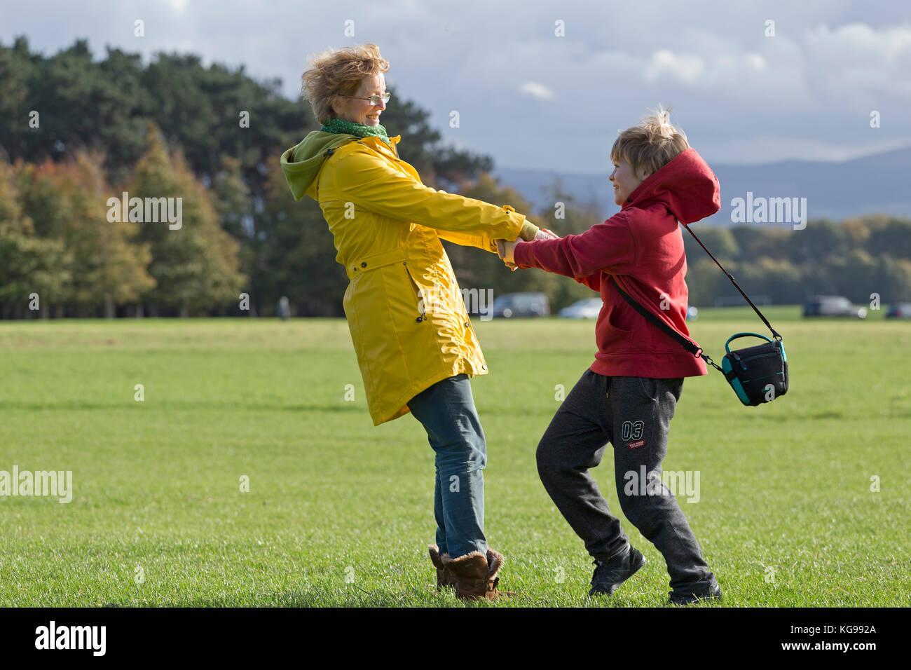 mother and son having fun at Phoenix Park, Dublin, Ireland - Stock Image