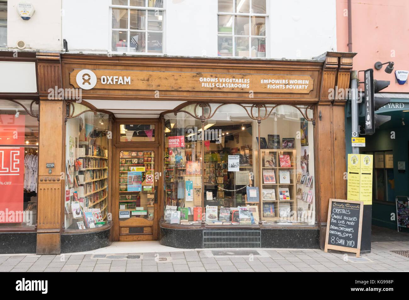 Oxfam shop with unusual signage Cirencester, England, UK - Stock Image