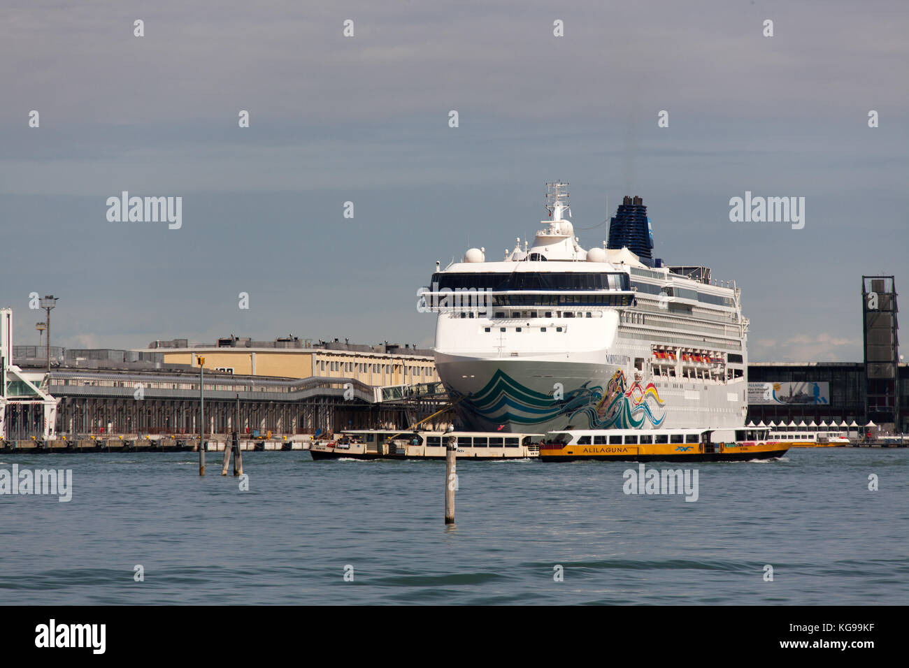 City of Venice Italy. Picturesque view of the Fusina Canal with the Norwegian Spirit berthed at the Venice Cruise Stock Photo